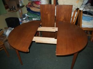1970s teak table with 2 extension leaves.