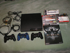PS3, 3 controllers, 2 charger cords, 16 games