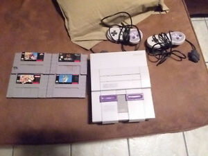 SNES with 5 games, 2 controllers.