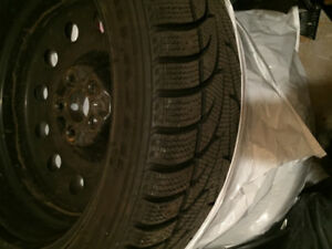 Four rims and winter tires from 2014 Hyundai Genesis