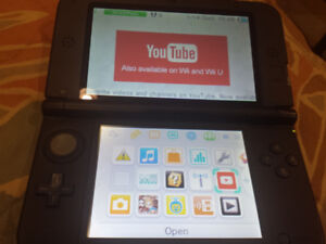 Black 3DS XL system with charger and stylus included.
