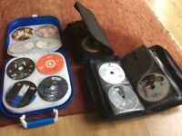 3 dvd cases with over 100 dvds