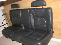 Mint cond. charcoal grey leather seat with console.