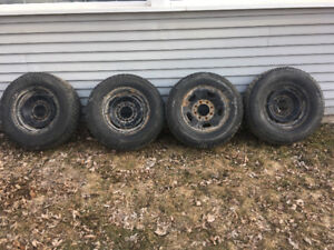 Nearly new 245/75/16 Arctic claw tires on GM 8 bolt rims