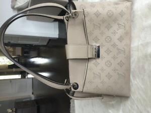 Genuine Louis Vuitton Sevres purse