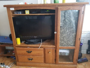 Solid oak tv stand and storage unit. Locking cabinet as well