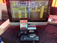 Sega megadrive console with controller, cables and game