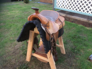 Western saddle, pad and stand