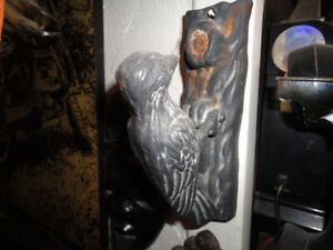 Wood pecker door knocker