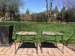 Wrought iron table base and four wrought iron chair frames