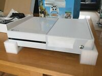 White Xbox One with games