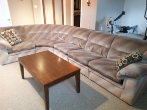 Coffee and 2 end tables.  Large sectional couch.