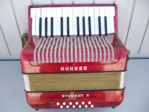 Accordion for sale.