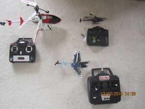 3 helicopters for sale with their hand controls.