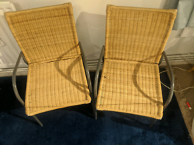 Pair of wicker style chairs