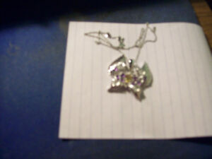 butterfly necklace silver in color with chain asking $100.00