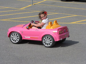 Barbie car for a little girl to drive.