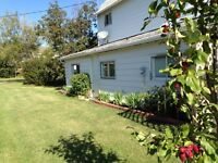 Camrose area Character Home/Single Garage set on double lot.