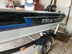 Tracker V14 Guide with Trailer a new motor and all new parts