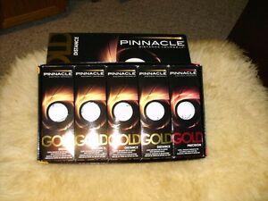15 Pinnacle Golf Balls. Brand New in Sleeves. Never Used.