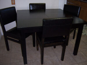 Black Dining Table with built-in leaf and 4 chairs