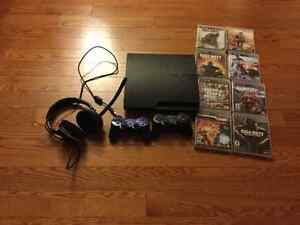 PS3 console, 2 controls, turtle beach head set, and games