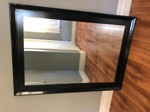 """Large black mirror 30"""" wide by 43"""" long."""