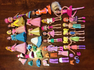 Large lot of Polly pockets with clothing and accessories