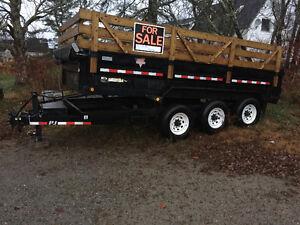 Triple axel tandem dump trailer