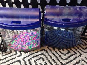 2 small fish tanks with gravel