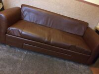 Brown faux leather sofa with storage