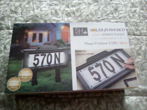 Solar powered address plaque