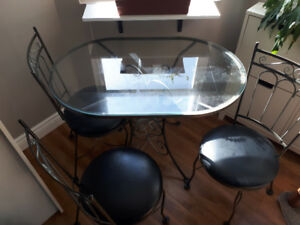 Glass dinner/patio table with 4 chairs
