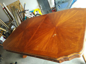Expandable solid wood dining table looking for a good home!