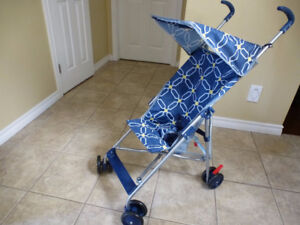 Umbrella stroller with canopy.