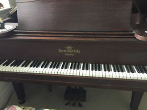 A 1oo year old Heintzmen 6 foot grand piano in good condition