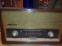 A vintage mid 20th century wooden cased Grundig valve radio. Model 3028 / GB AM / FM receiver