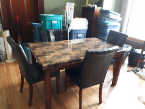 Marble look dining table with four chairs