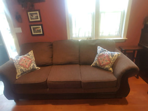 Brown material and wood couch 1 year old
