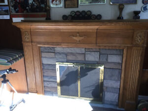 Fireplace mantel and glass doors for sale