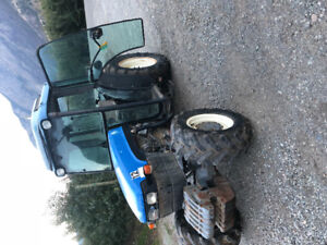 New holland tn75f 4x4  cab tractor with woods mower