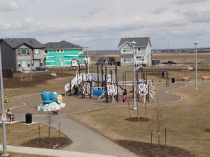 Watch the Kids at the Park from Your Veranda