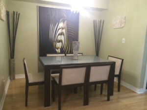 Dining Room Table with Glass Top and 6 Wide Chairs