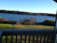 LAKEFRONT WITH 3.85 ACRES, 2+1 BDRMS