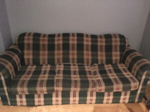 Plaid sofa, very comfy, great for a cabin or cottage!