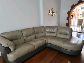 Leather corner sofa with electric reclining chair