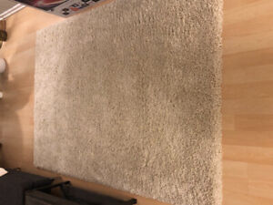 New White Shag Rug! 5ft'5inches x 7ft'5inches  $200