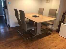 Light oak effect dining table
