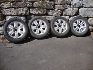 "4 - 20"" Ford F-150 Aluminum Rims with Snow Tires"