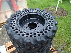 New Solid Skid Steer Tires 10 x 16.5 set of 4   $2200
